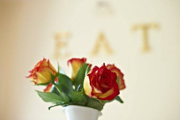 Red and Orange roses in a varse