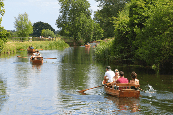 Boat rowing down a river in Essex